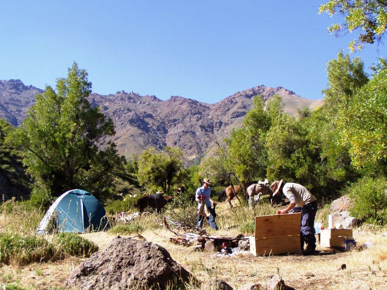 setting up camp, horse riding in the Chilean Andes