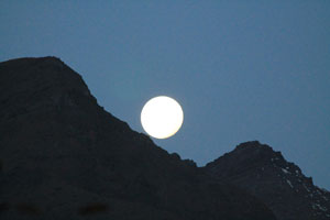 full moon rising over the Andes mountains